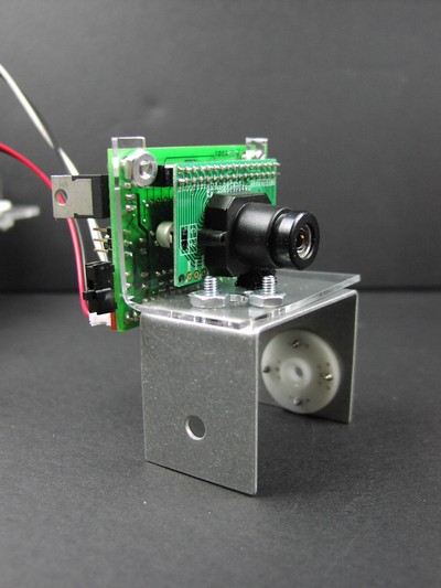 CMU camera mounted to top bracket and plastic